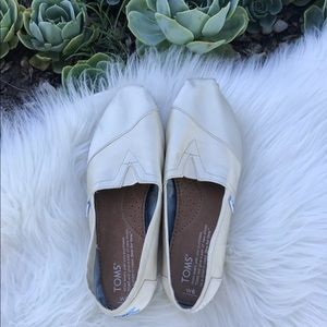 TOMS cream colored slip ons